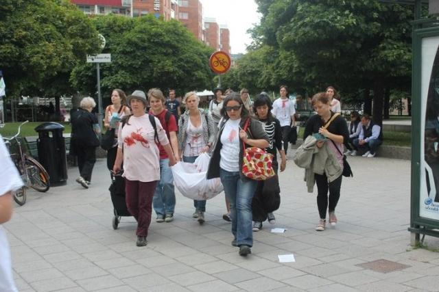 Bild på ofogare vid die-in aktion i Stockholm