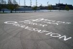 Text målad på asfalten: Nuclear Attack Terror Organisation